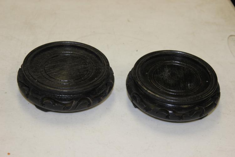Pair of Carved Vase Stands