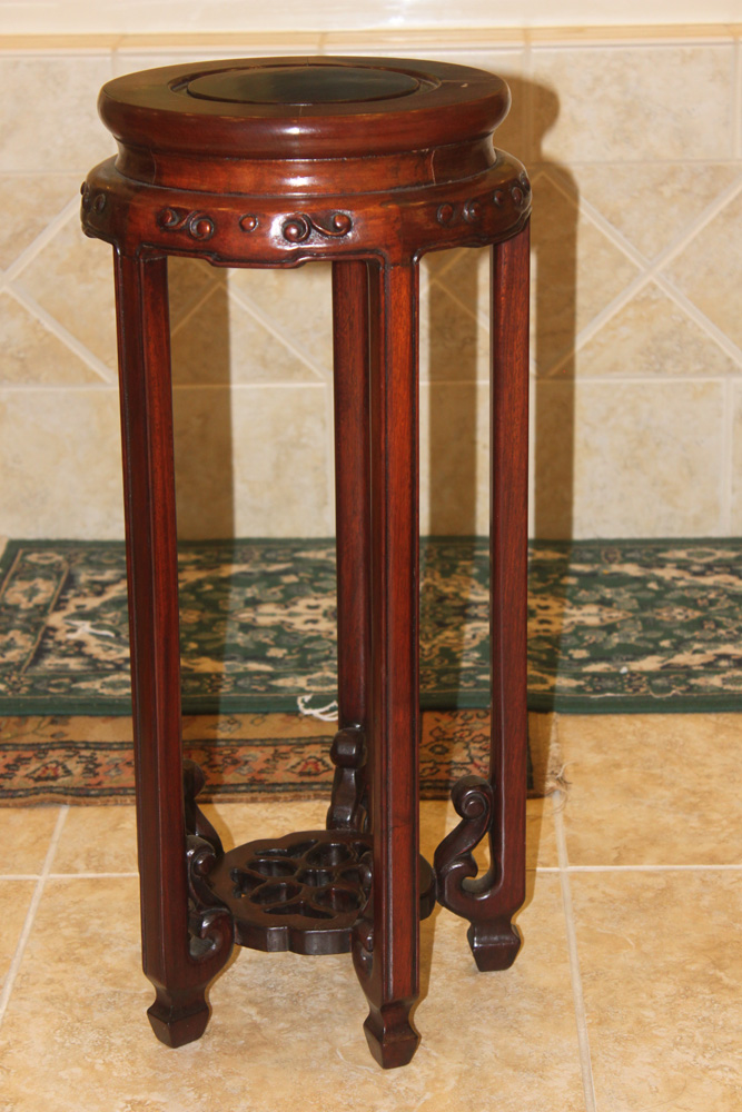 Well Carved Rosewood Stand