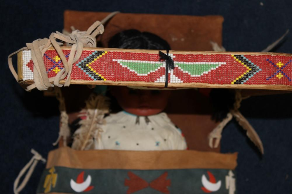 A Native Indian Leather Carlson Doll With Leather Blanket