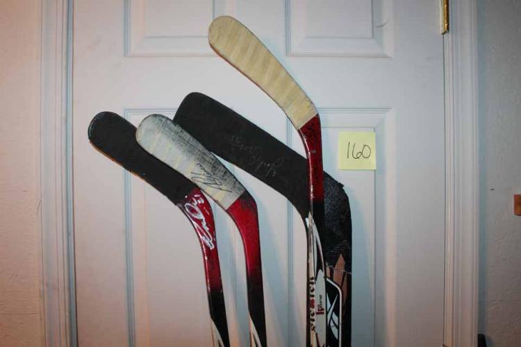 4 autographed game-used hockey sticks: