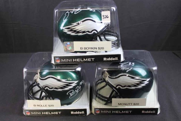 3 autographed football mini helmets: