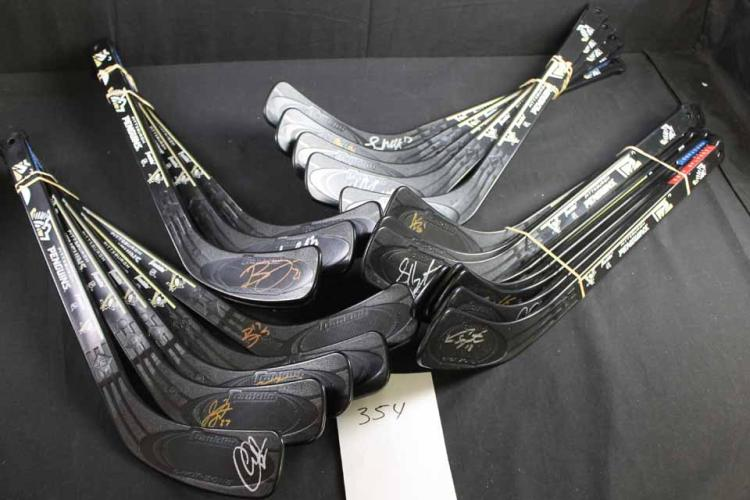Autographed hockey sticks: