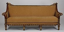 Parcel gilt carved mahogany sofa