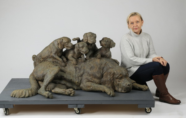 Patinated bronze sculpture of dog & puppies