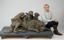 Patinated bronze sculpture of dog & puppies