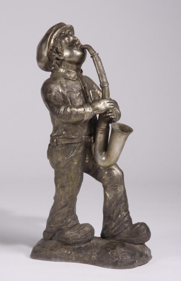 Bronze sculpture, boy playing saxophone, 37