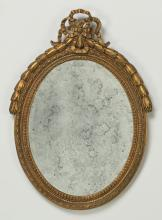 Neoclassical style gilt mirror, 24