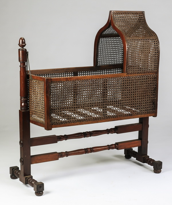 Early 20th c. swinging cradle in woven cane, 47