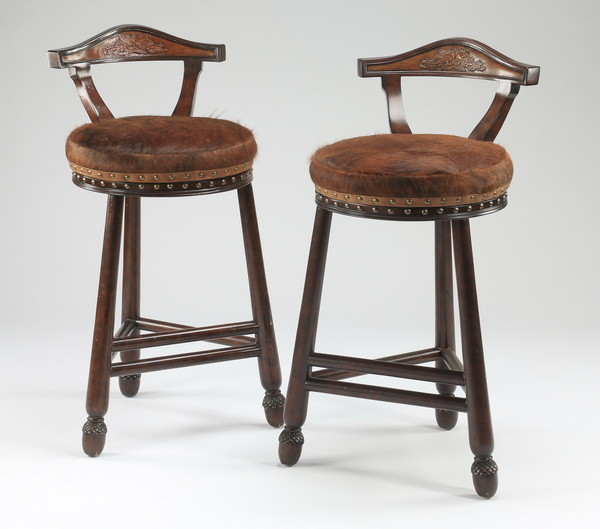 Hair on hide upholstered bar stools, 41