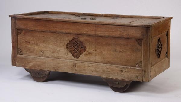 Vintage carved wood storage cart on wheels