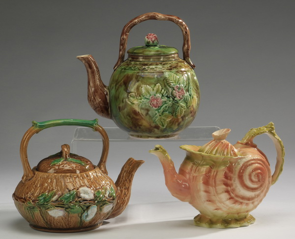 Group of three majolica teapots, 8
