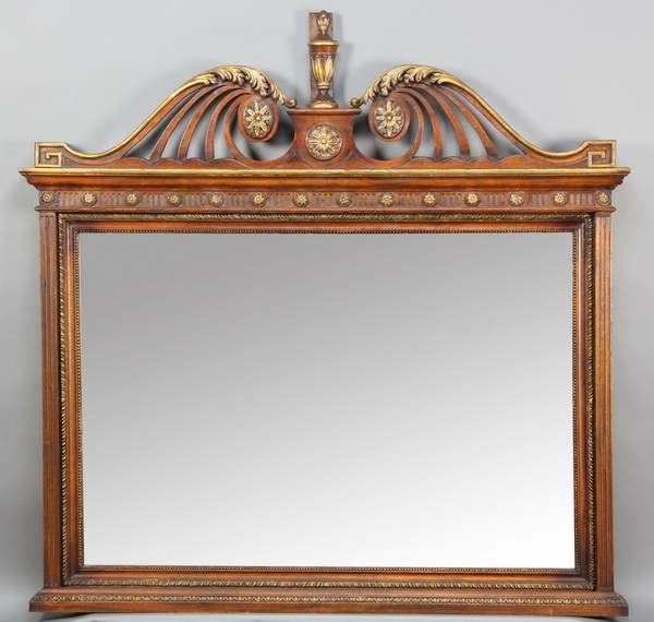 Carved and parcel gilt mahogany mirror, 64