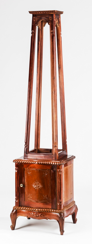 Mahogany obelisk-shaped display stand, 73