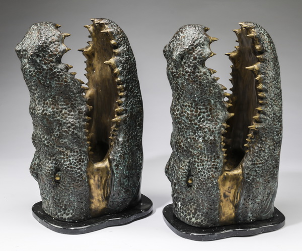 (2) Patinated bronze alligator heads on bases, 23