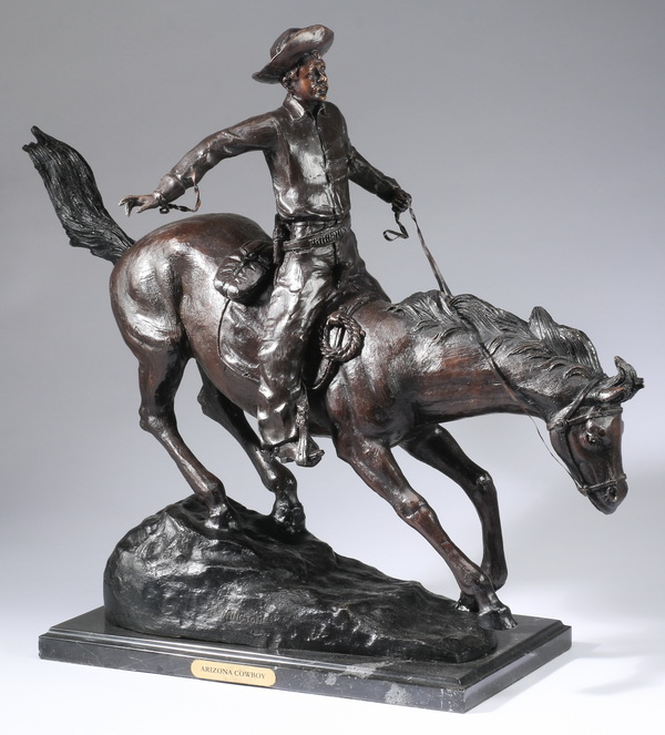 Bronze sculpture 'Arizona Cowboy' after Remington