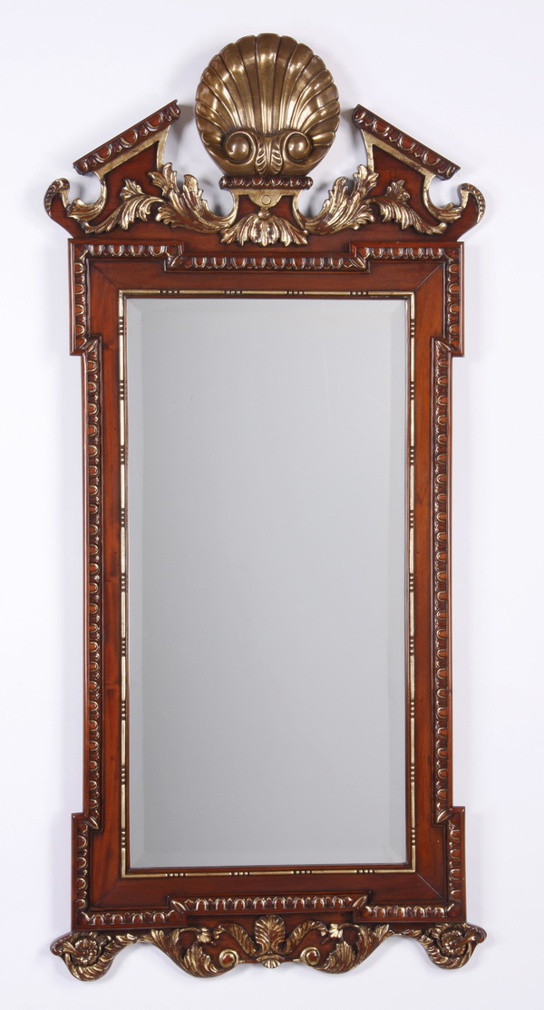 Carved and parcel gilt mahogany mirror, 63