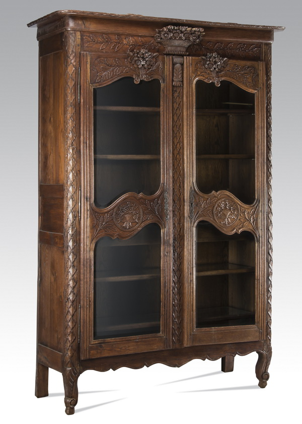 19th c. French Provincial carved oak vitrine