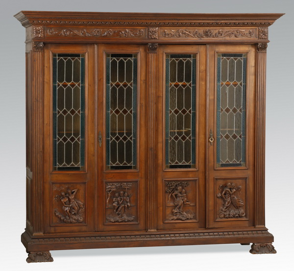 19th c. Continental carved oak bookcase, 86