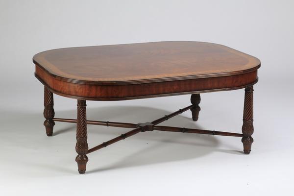 Oversized mahogany cocktail table, 52