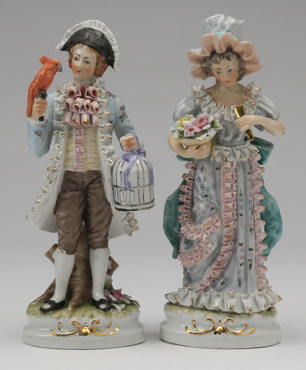 (2) Continental porcelain figurines, 11