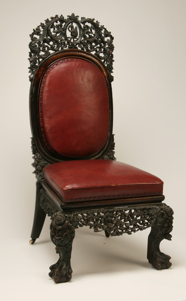 19th c. Burmese carved chair in leather, 54