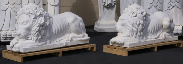 (2) Carved marble recumbent lions, 60