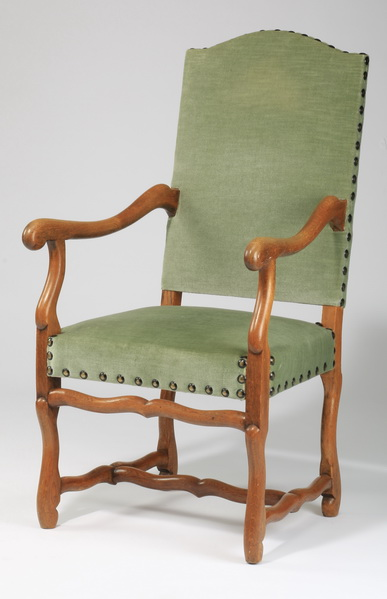 French Provincial carved armchair in velvet