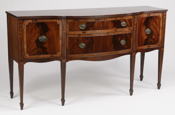 Serpentine sideboard in the Federal taste, 69