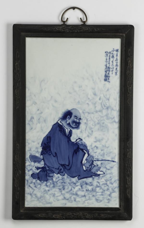 Chinese porcelain plaque depicting a scholar, 25