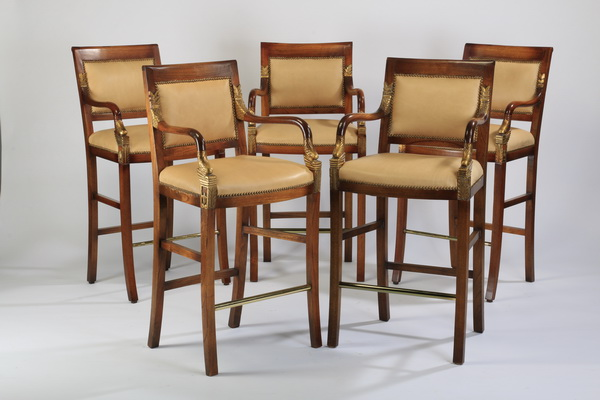 (4) Carved mahogany bar stools in leather