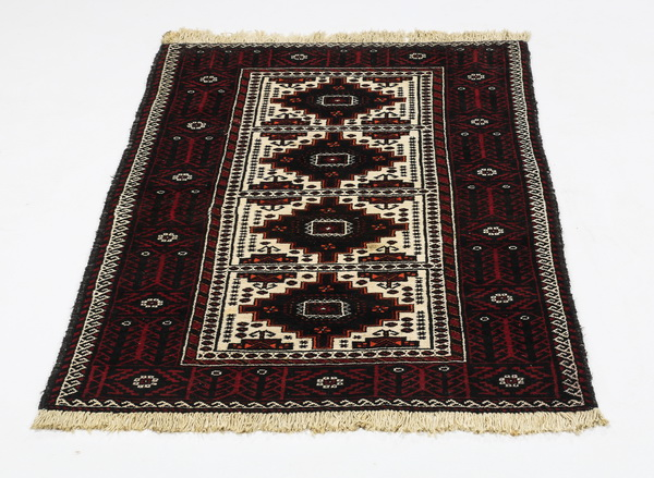 Hand knotted Baluch wool rug, 6' x 3.5'