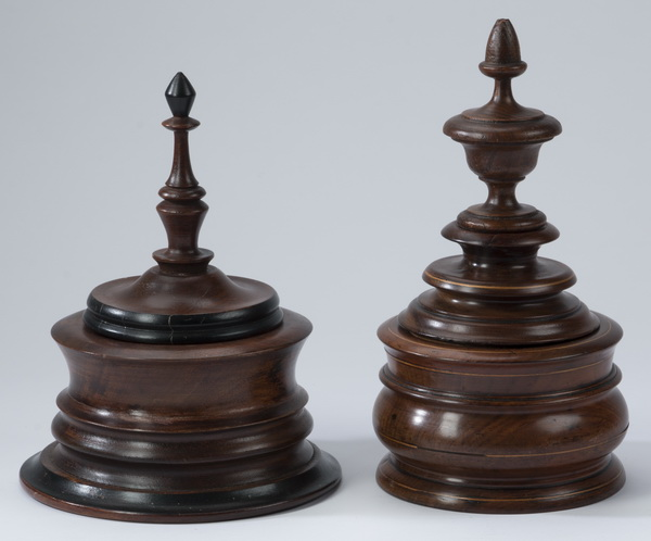 (2) Carved wood tea caddies with turned finial lids