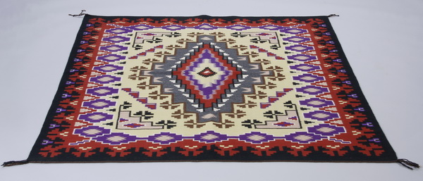 Southwest inspired hand woven wool area rug, 5 x 6