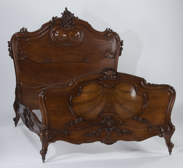19th c. French Rococo style carved walnut bed