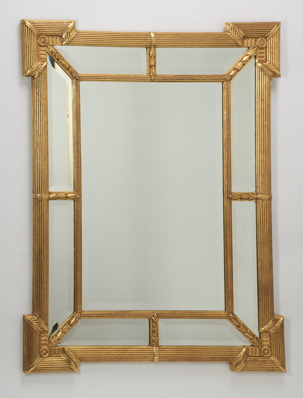 Carved gilt wood beveled mirror, 45