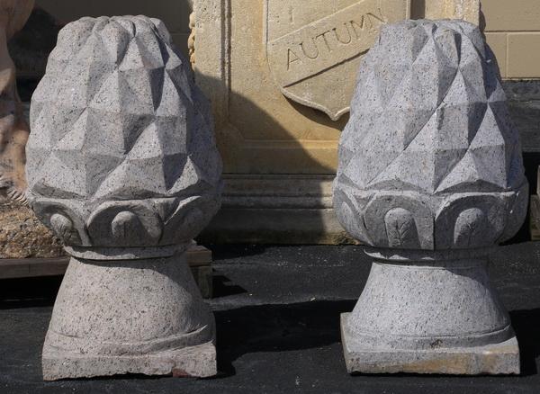 Pair of carved granite pineapple finials 34
