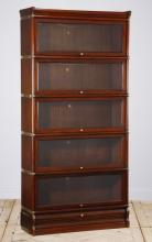 Five tier mahogany lawyer's bookcase, 71