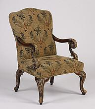 Carved and parcel gilt mahogany armchair