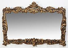 Parcel gilt carved mahogany mirror