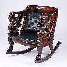 Early 20th c. carved mahogany rocking chair