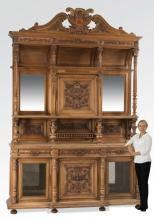 Monumental French carved walnut cabinet, 128