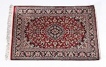 Handwoven silk Persian rug, signed