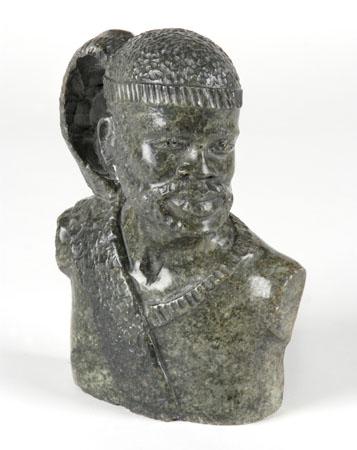 Carved Zulu tribesman bust, in serpentine marble