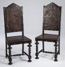 (2) Brazilian mahogany & embossed leather chairs