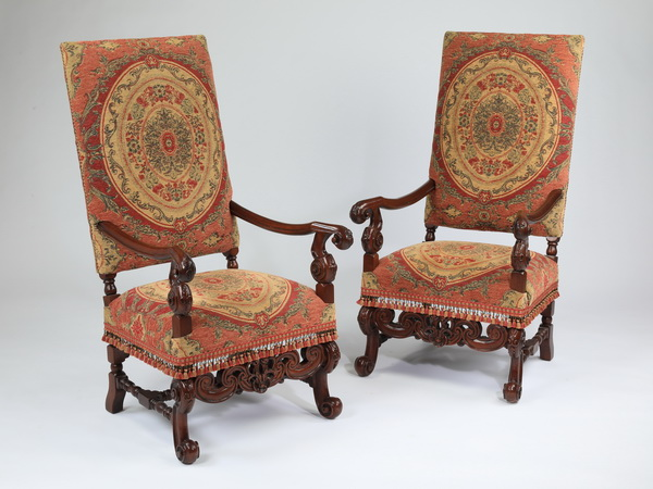 (2) Louis XIV style carved walnut fauteuils, 51