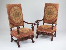 (2) Louis XIV style carved walnut fauteuils, 51