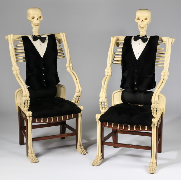 (2) Carved mahogany skeleton-form armchairs, 54
