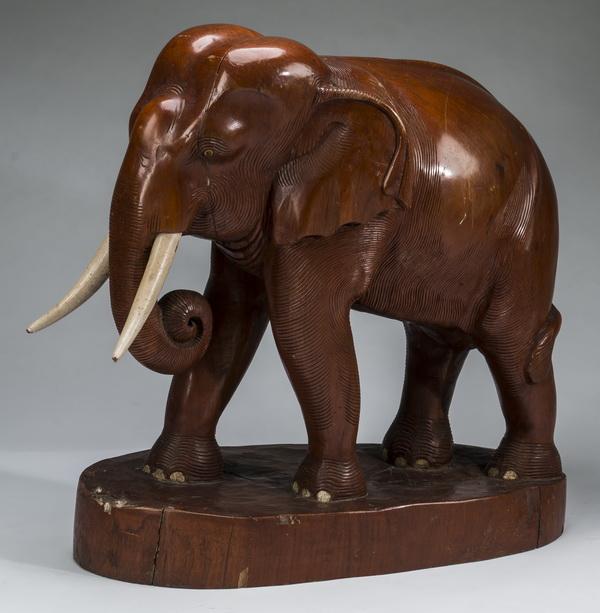 Carved hardwood elephant sculpture, 32