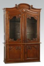 Early 20th c. French Provincial carved oak vitrine