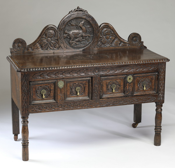 19th c. English Jacobean style carved oak chest, 43